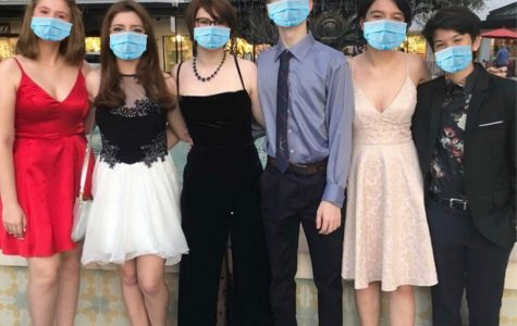 A group of students with masks edited on, pose together before heading to the 2019 Homecoming dance.