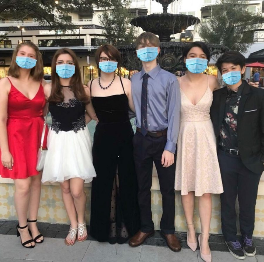 A+group+of+students+with+masks+edited+on%2C+pose+together+before+heading+to+the+2019+Homecoming+dance.%0A