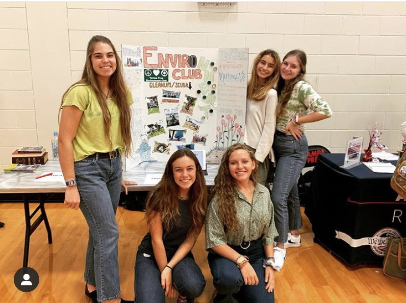 Members of the Environment Club pose for a photo at the 2019 club fair in the gym. Due to COVID-19 restrictions, the club fair will be virtual this year. Instagram/tptreehuggers